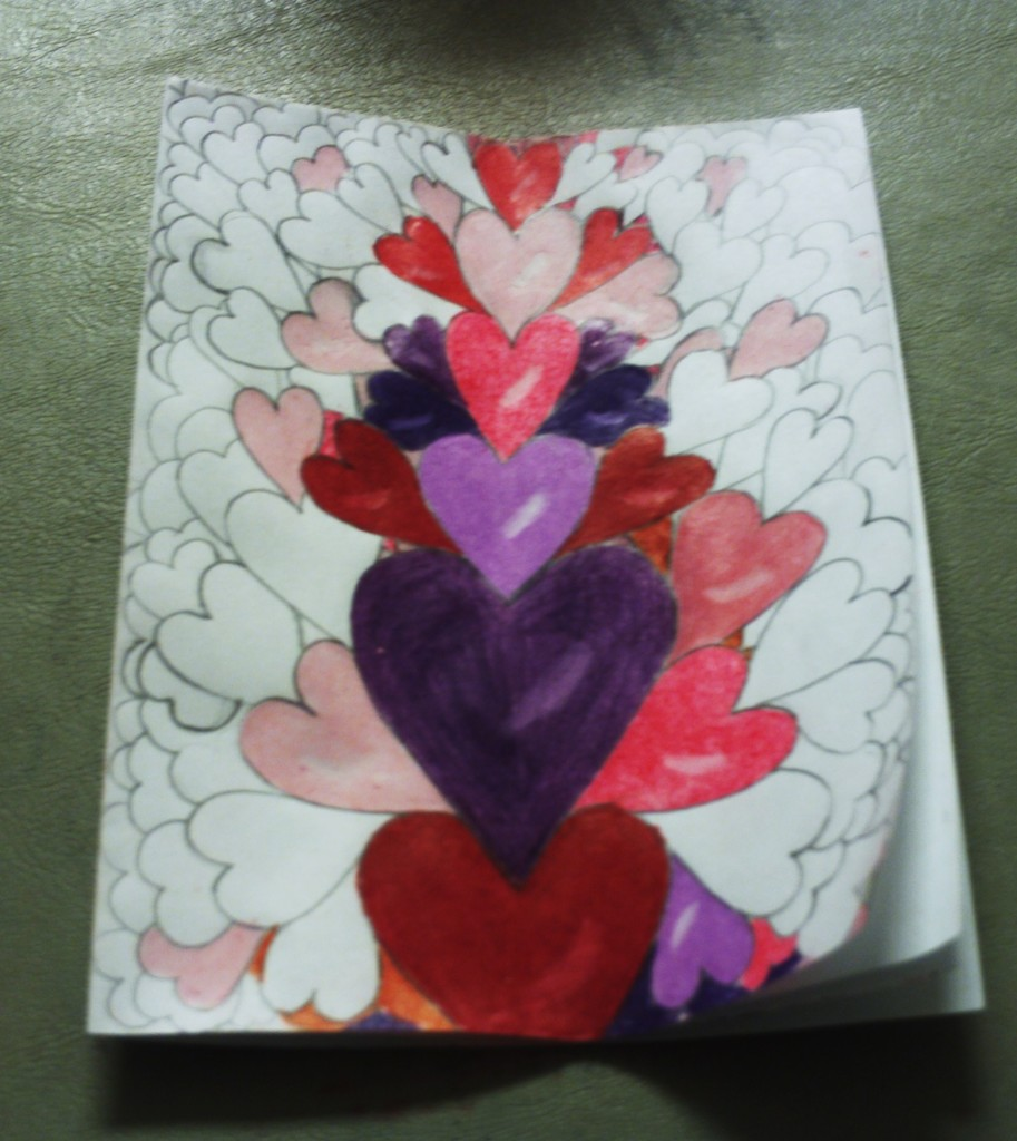 Drawing Hearts On A Valentine Card