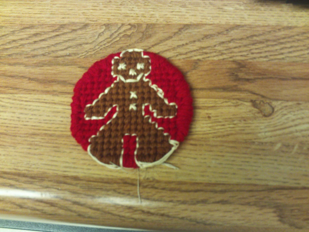 White embroidery floss was used to create the frosting on the ginger bread man.
