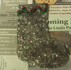 Adding Green And Red Glitter Accents To The Top of Stocking