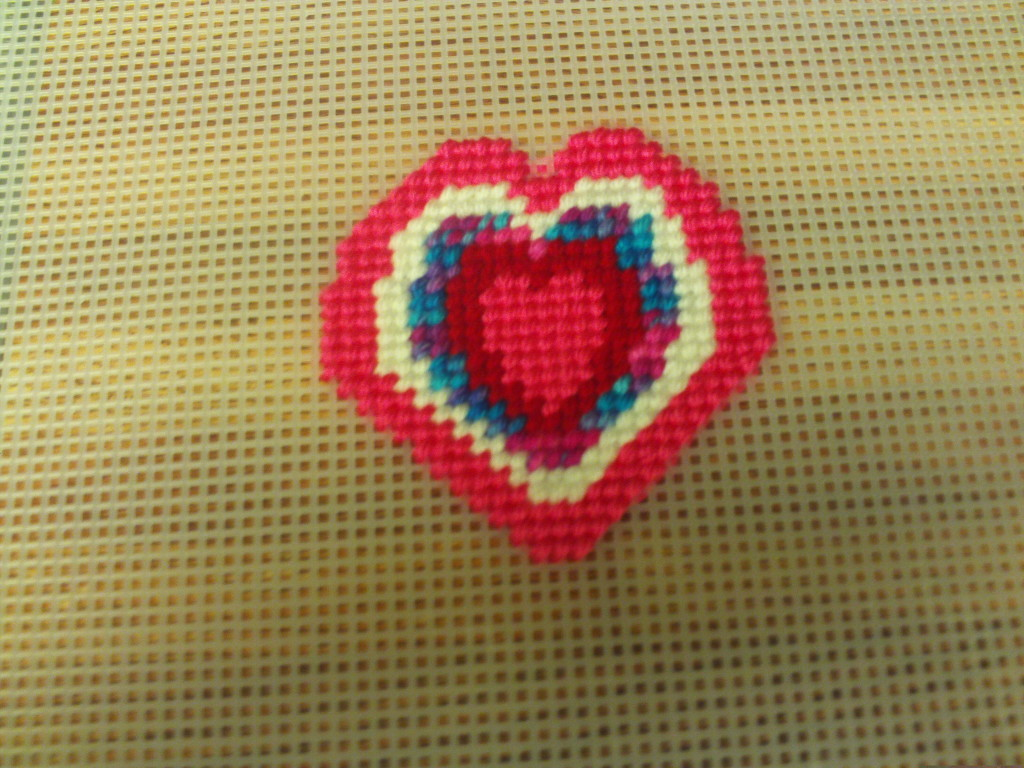 Here I am cross stitching on the pink layer of the pattern.