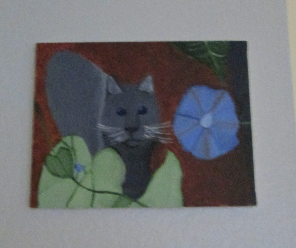 Acrylic painting of a grey cat sitting next to a morning glory.  I grew up with many cats who enjoyed sitting next to morning glories, which was the inspiration for this painting.
