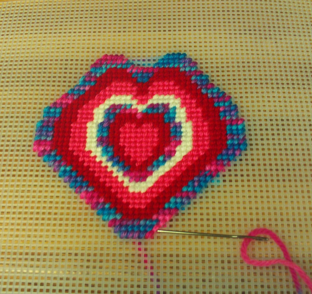 Here I am cross stitching on another multicolored layer.