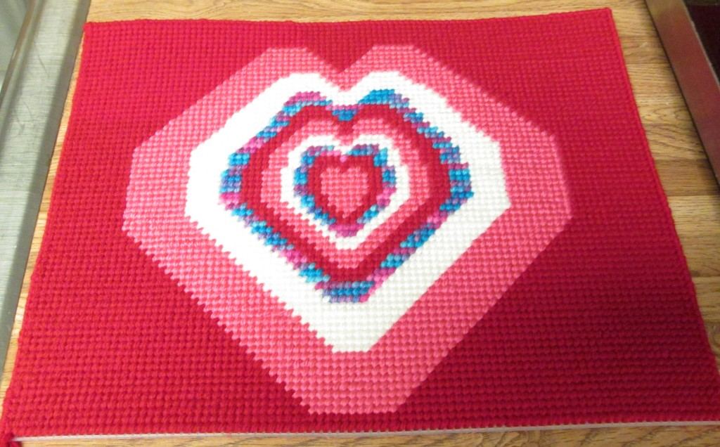 Cross stitching the left side of the rectangle.