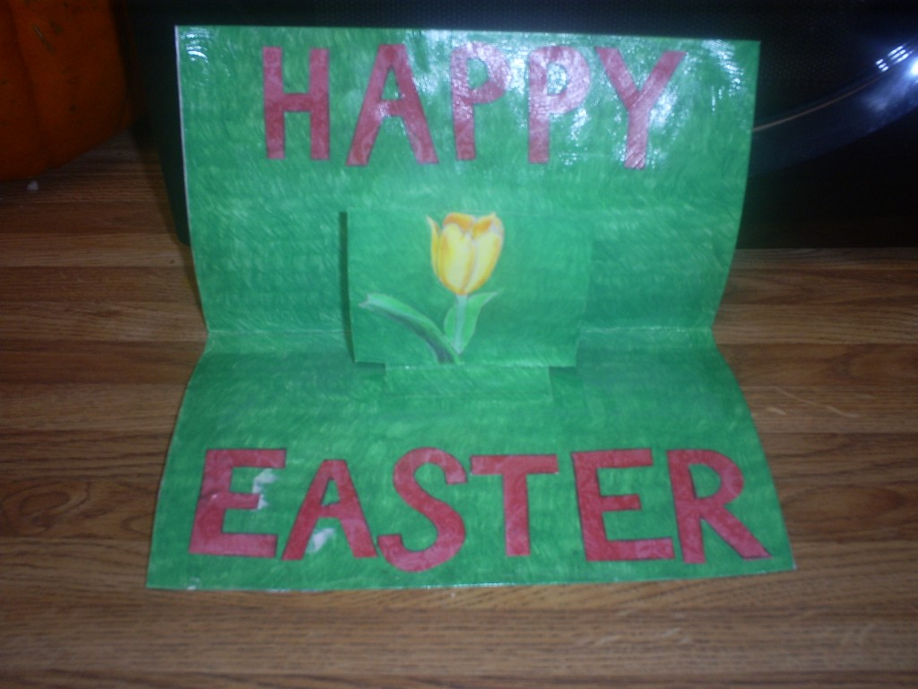 Here is a pop-up Easter card that I made with a hand drawn daffodil and hand drawn grass in the background.