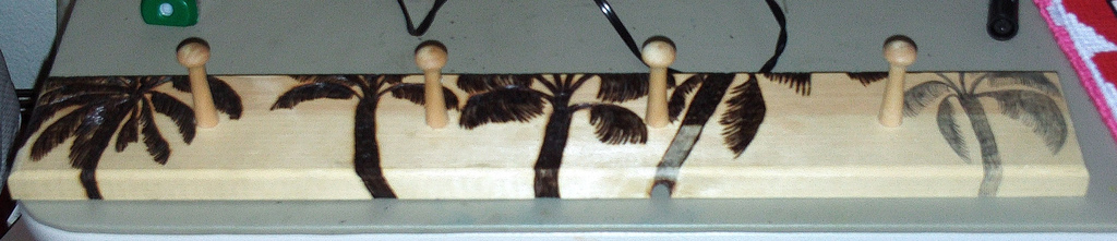 Wood Burning Palm Trees On Rack
