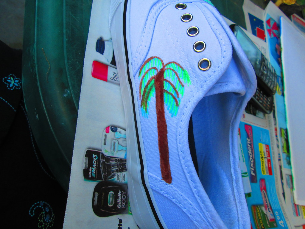 I used the brown and green fabric markers to draw a palm tree on the side of the shoe.