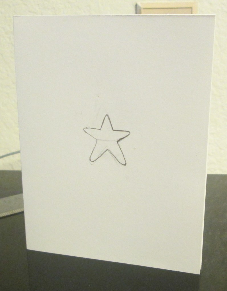 First I drew a star in the center of the quarter-fold card.