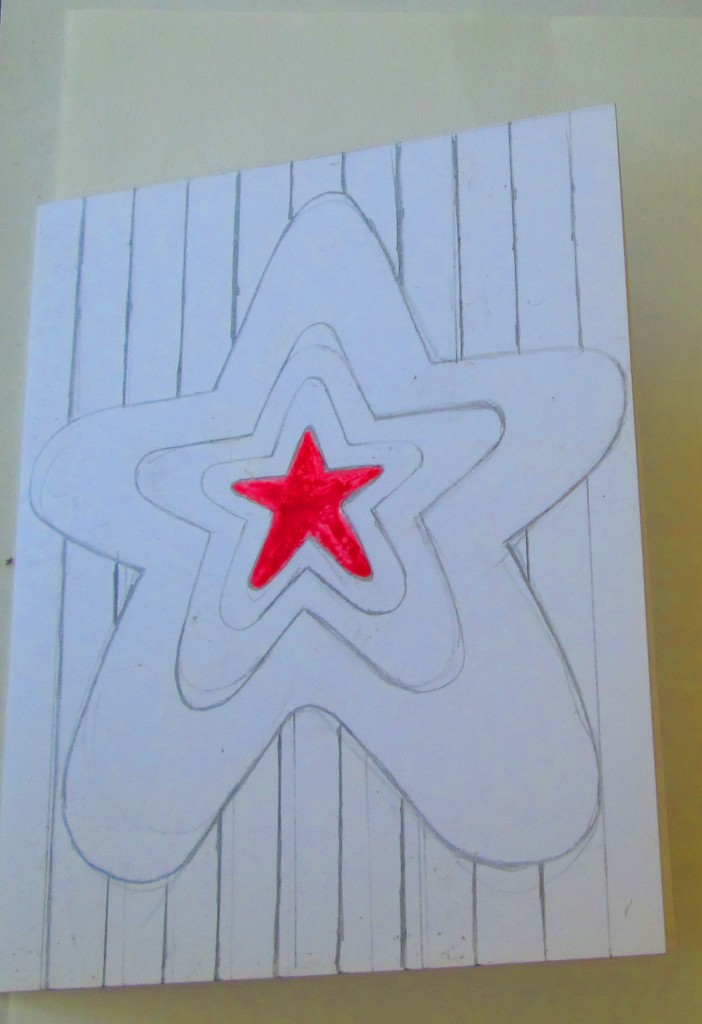 First I painted in the red star on the center of the card.