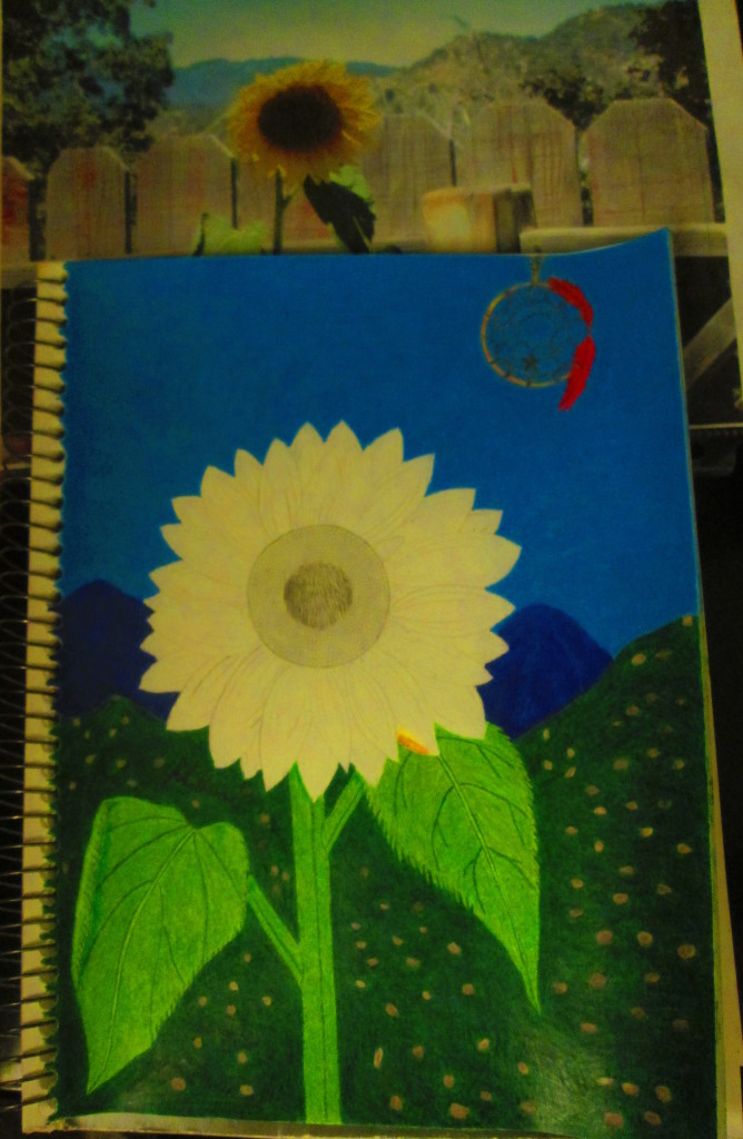 Here I have finished coloring the the leaf and stem of the sunflower.