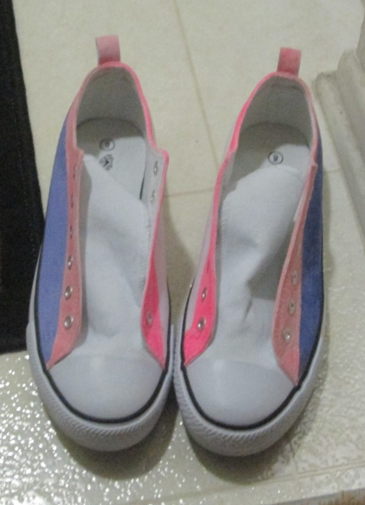I used a light purple fabric marker to color a stripe on the outside edge of each shoe.