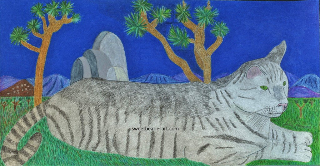 Stripey cat is a cool kitty who lives lounges near Joshua trees.