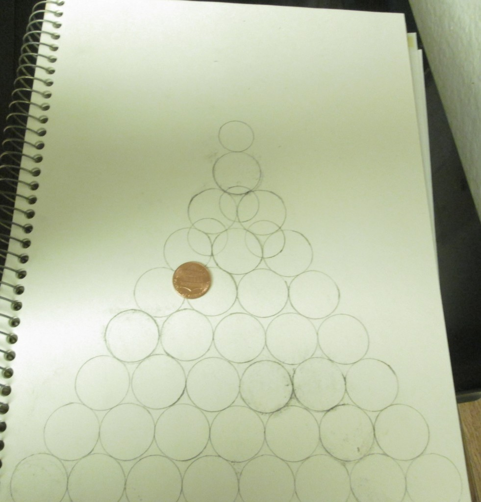 Here I traced around a penny to create the ornaments on the tree.