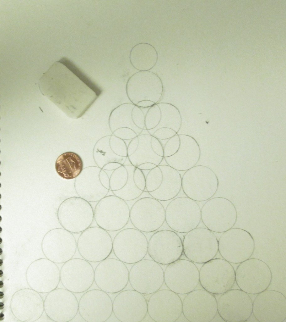 I continued tracing around the penny to make the ornaments on the tree.