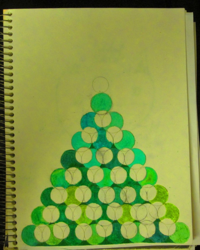 I used several different shades of green crayons to color in the Christmas tree.
