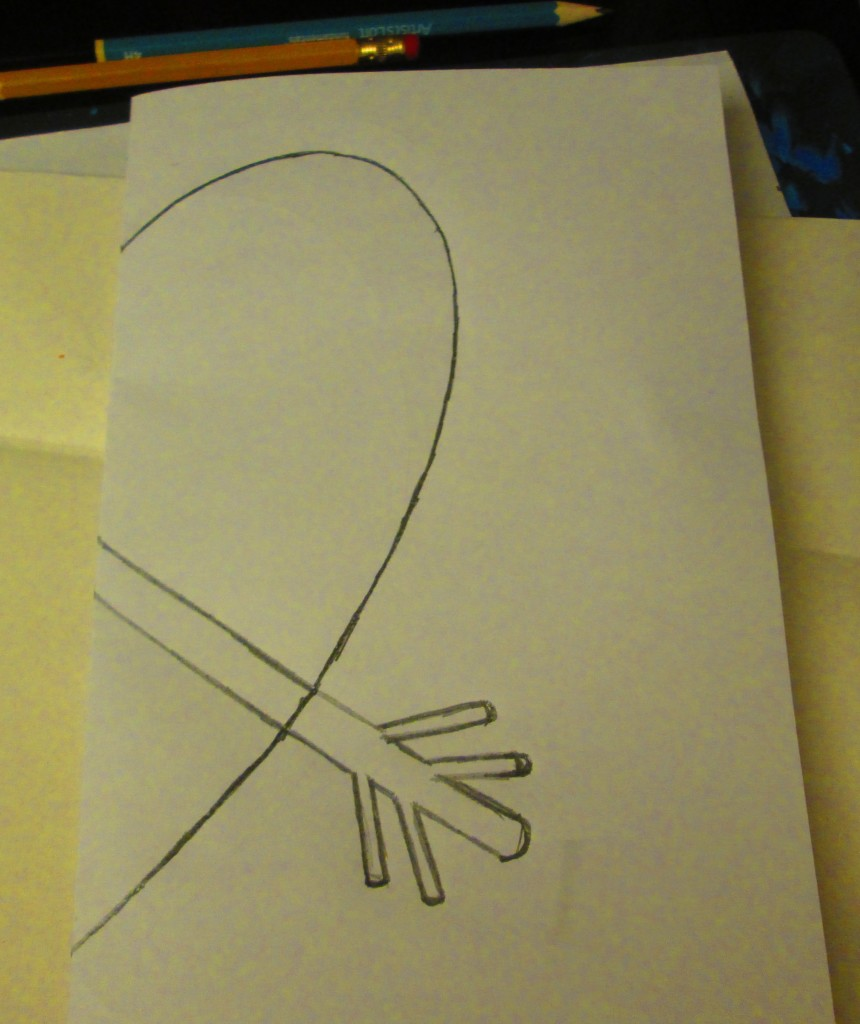 I folded the sheet of paper in half so I could draw a symmetrical heart. Also, I drew the bottom part of the arrow.