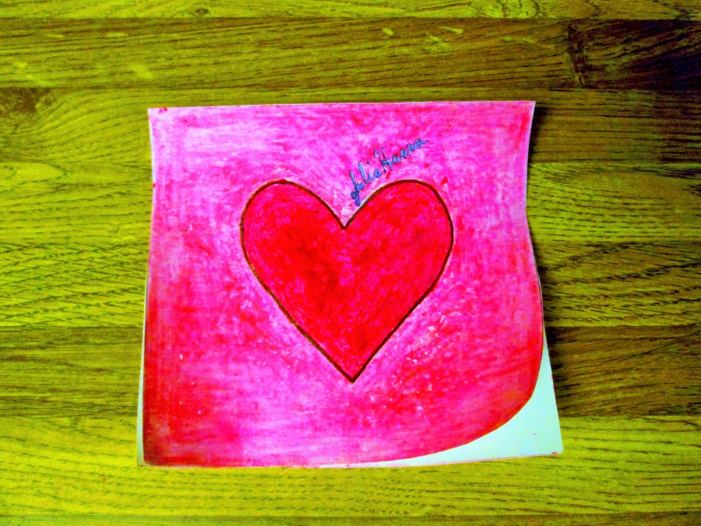 I used a pink crayon to color in the background behind the heart.