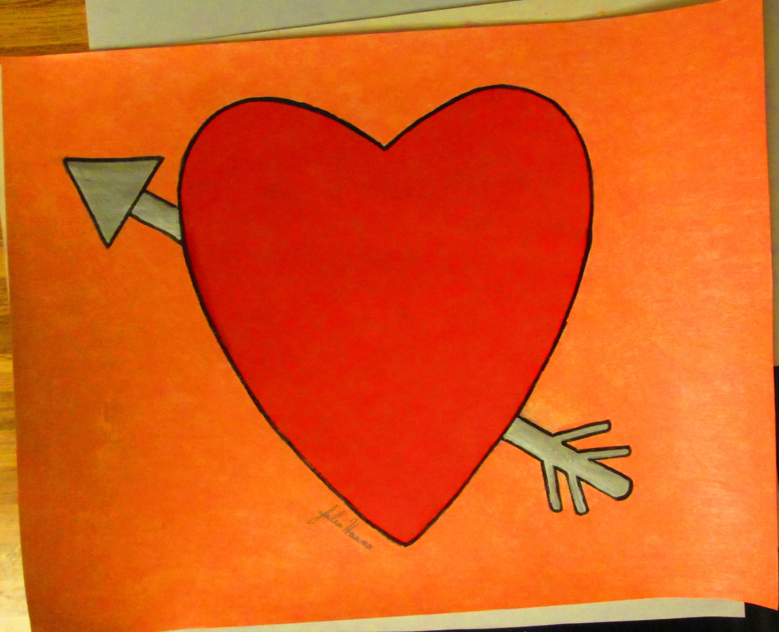 The completed heart and arrow illustration.