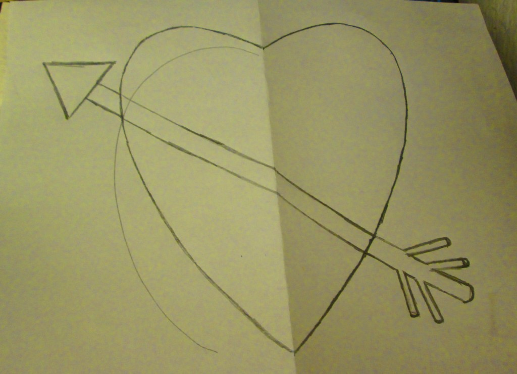 I unfolded the sheet of paper, and used the impression from the half traced heart to complete the shape. Thus, I was able to create a symmetrical heart. Also, added the arrowhead to the arrow.