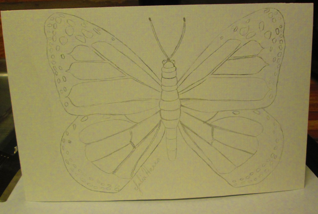 First I drew a butterfly on the front of a handmade card.