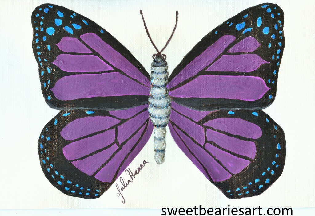 The butterfly painted was created with acrylic paints on a front of a handmade card.