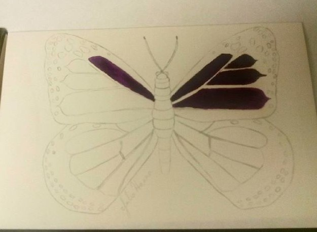 Purple acrylic paint was used to paint in the large portions of the butterfly.