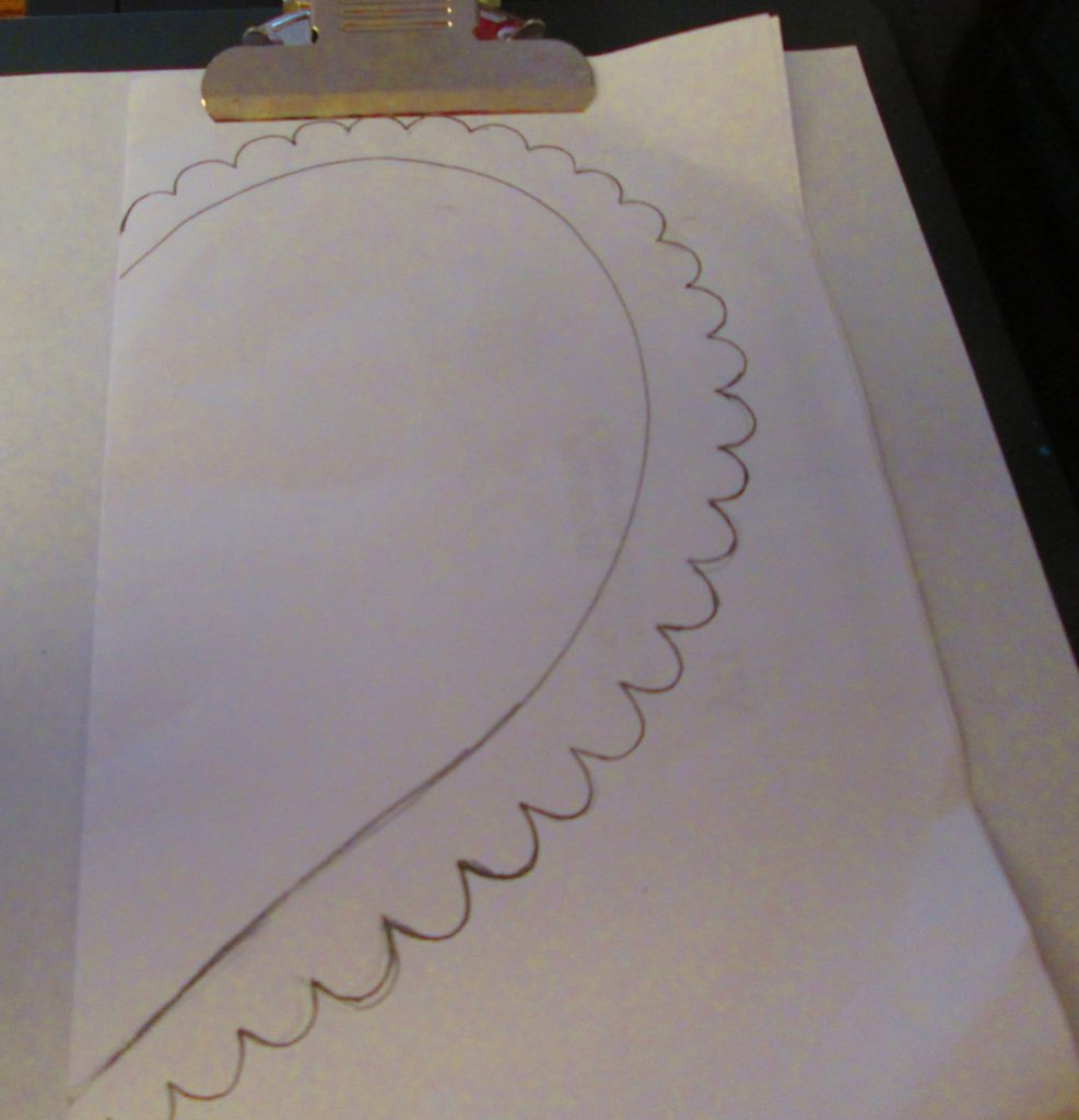 Fold a sheet of tracing paper in half and draw a heart on it.