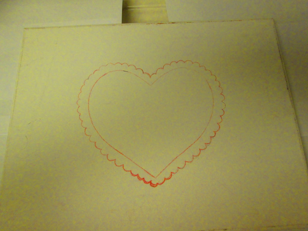 I used the red colored pencil to go over parts of the heart that did not completely transfer onto the canvas.