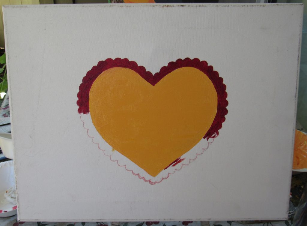 I painted the heart with an orange center, and the scalloped edge was painted with red oil paint.