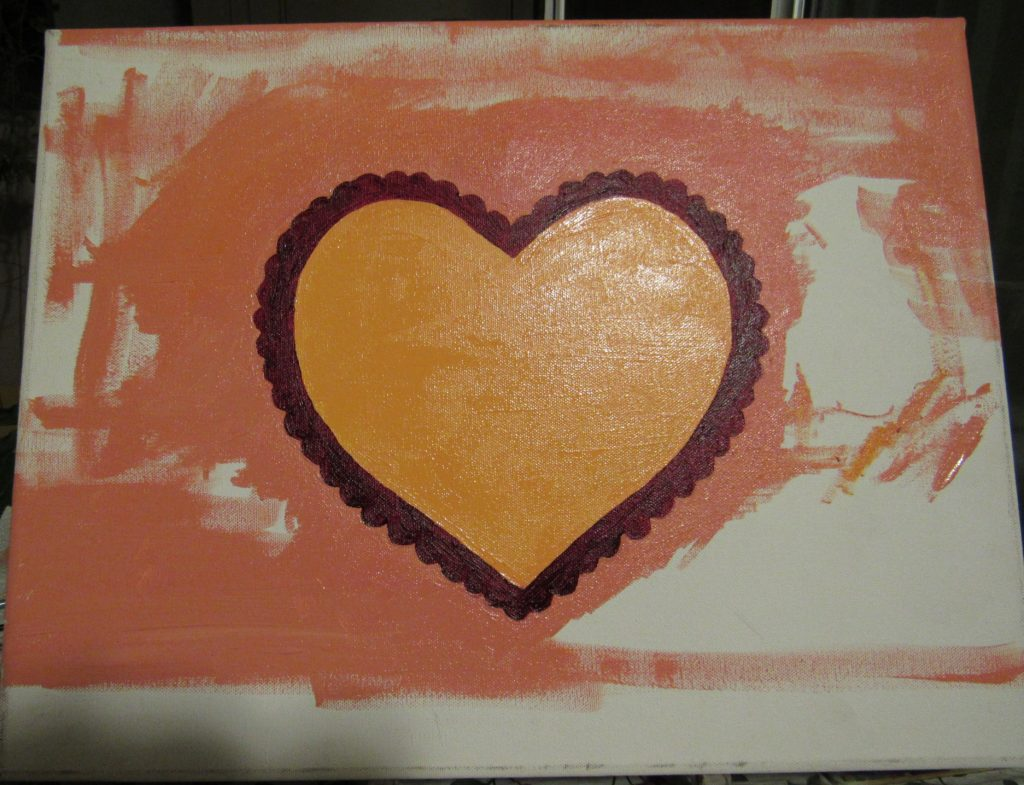 I used pink paint to fill in the background behind the heart.