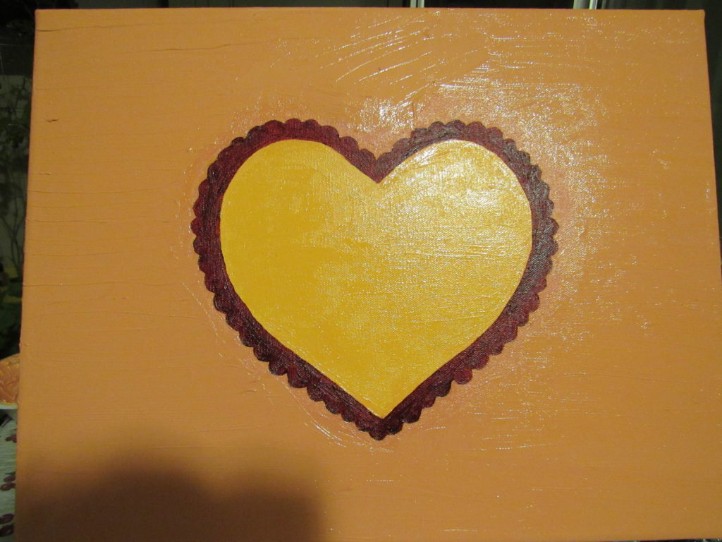 After I finished painting the heart on the canvas, I allowed the oil paint to dry for a few days. I need to go back in and touch up some of the scalloped edge, but the painting is almost finished.