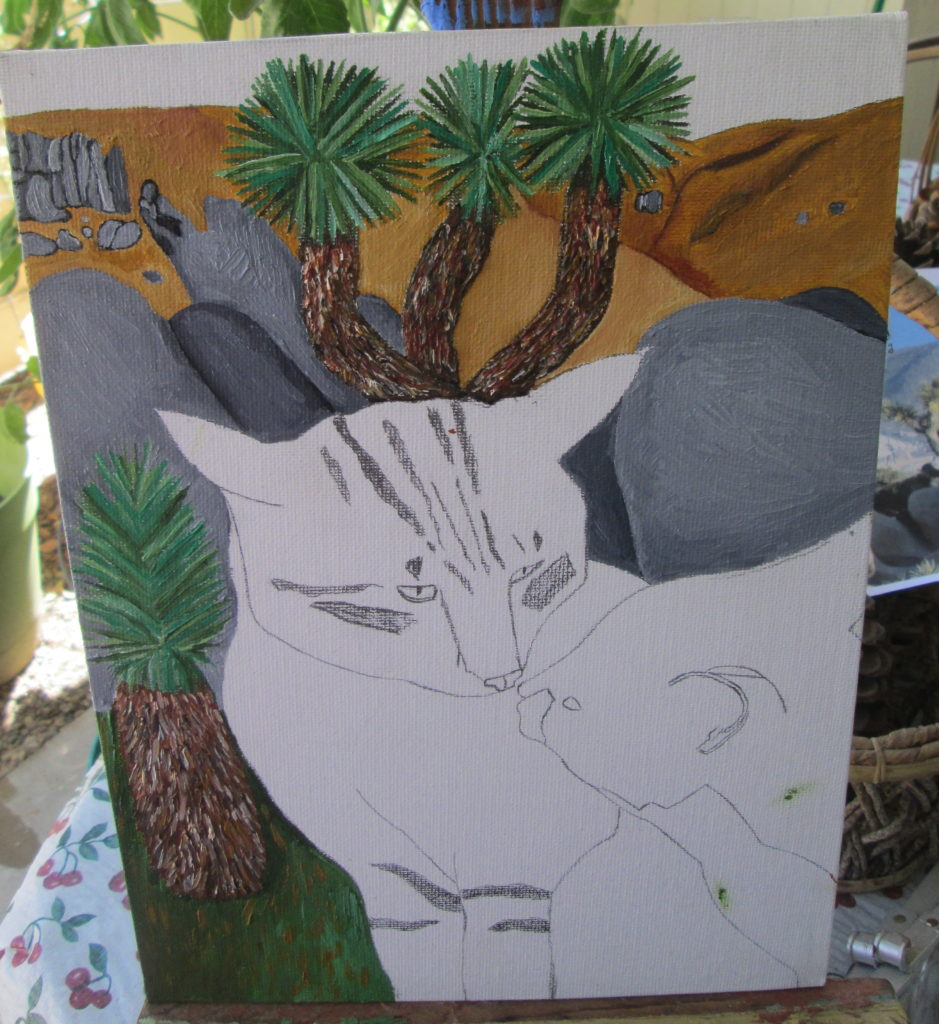 I painted the mountains and the Joshua tree behind the two cats.